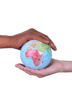 famine: black and white hands holding globe