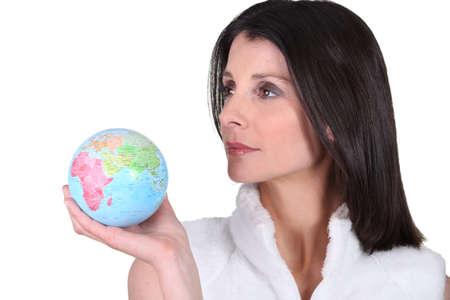 abroad: woman holding a globe