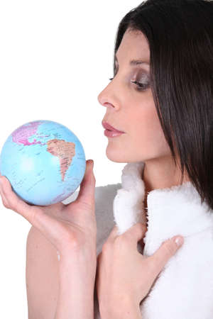 Woman blowing on a mini globe photo