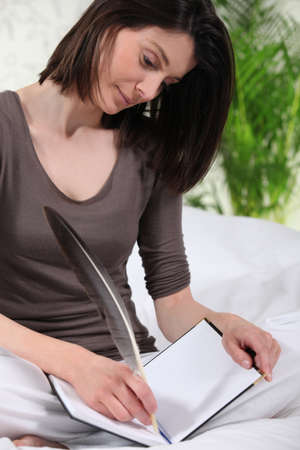 inventing: Woman writing with pen