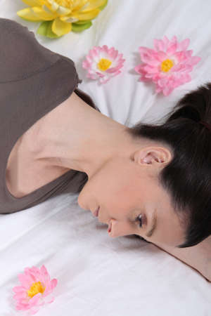 woman in depression lying in her bed Stock Photo - 13850603