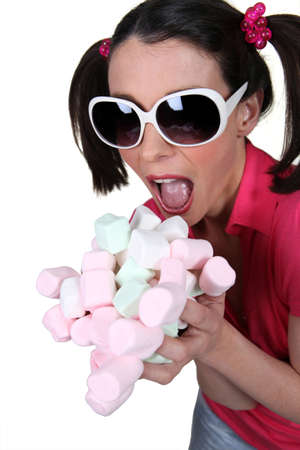 going crazy: Girl going crazy for marshmallows