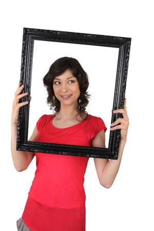 audacious: Woman holding a picture frame