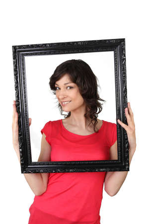 Brunette woman with black picture frame photo