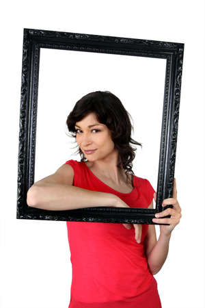 arrogant teen: Woman holding herself within a picture frame Stock Photo