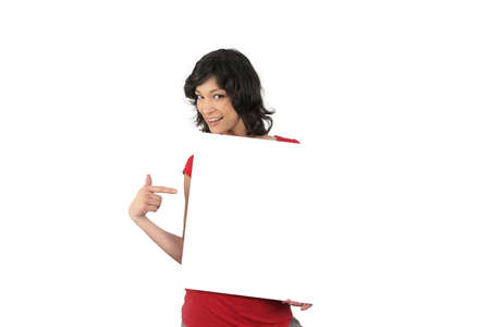 Enthusiastic woman pointing to a blank sign Stock Photo - 13847729