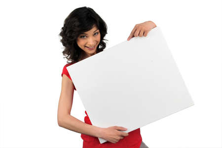 Brunette woman behind the white panel photo