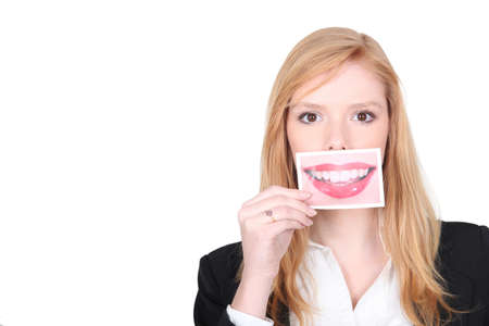 big teeth: Woman with picture in front of her mouth Stock Photo