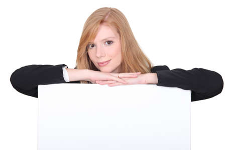 viewpoint: redhead woman behind white panel