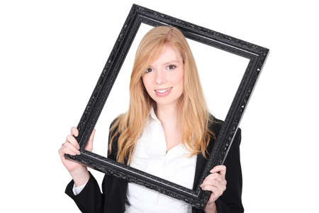 fair skinned: Young woman holding a picture frame around her head Stock Photo