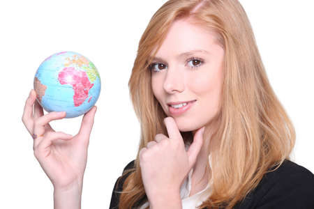 online internet presence: Businesswoman contemplating a globe