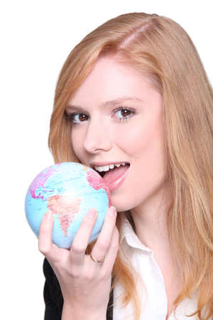 Young businesswoman eating the world photo