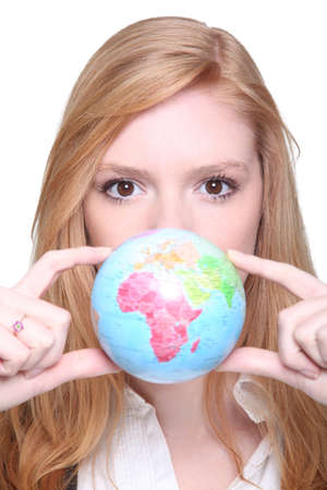 young woman showing a little globe photo