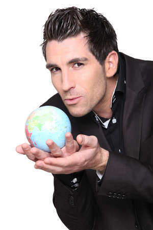 young businessman with globe in his hands Stock Photo - 13848814