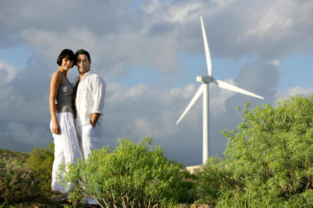 Couple stood on wind farm photo