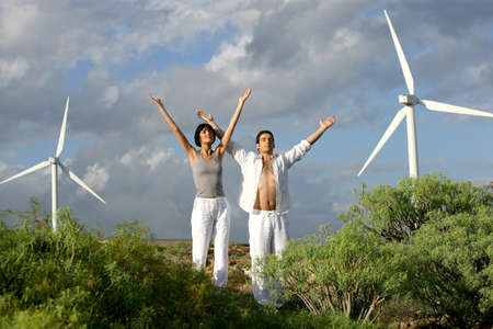 Zen couple on a wind farm Stock Photo - 13850651