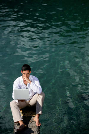 Businessman sat by water photo