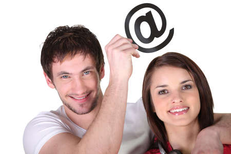 Couple with email symbol Stock Photo - 13849099