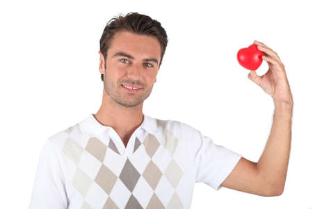 preppy: Holding a heart-shaped object Stock Photo