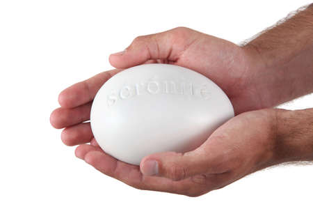 Hands holding a stone marked serenite photo