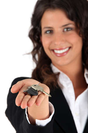 agents: Woman giving keys Stock Photo