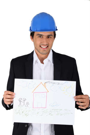 construction businessman holding a child drawing of a house photo