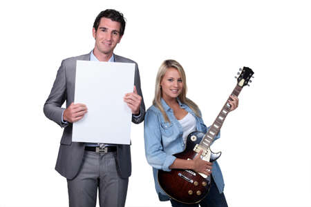 teaching music: Blond teenager guitar lesson Stock Photo