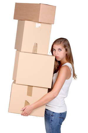 Young woman carrying a pile of boxes photo