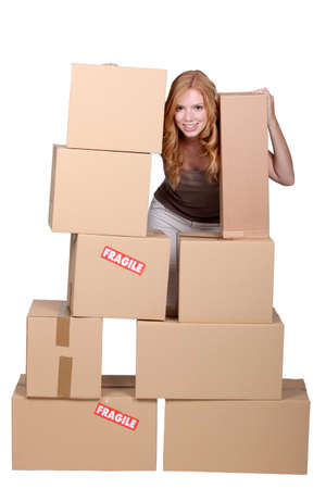 breakable: redhead woman and cardboard boxes