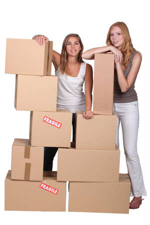 Girls surrounded by boxes photo