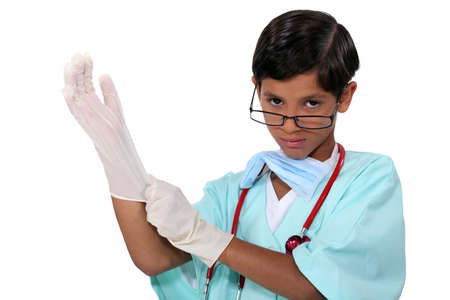 Boy dressed as surgeon photo