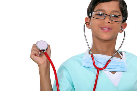 role play: Young child holding a stethoscope