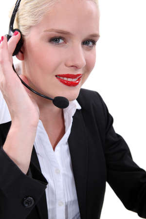 Fair-skinned woman wearing a headset photo