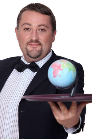 demanding: elegant man with globe on a tray