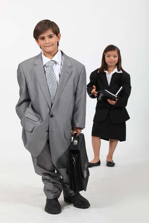 Children dressed in suits Stock Photo