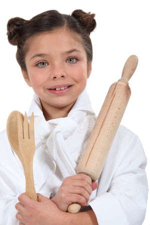 make belief: Girl pretending to be a cook