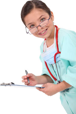 Young girl dressed up as a doctor photo