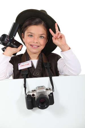little girl dressed as a adventure reporter photo