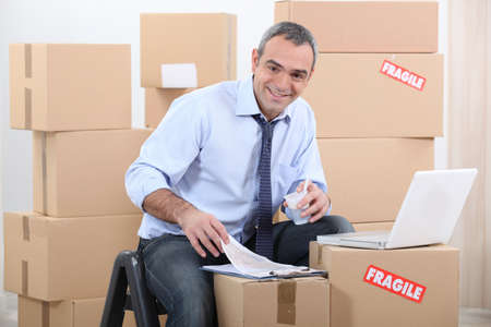 man moving into a new apartment Stock Photo - 13867581