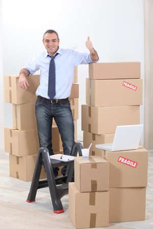 transfer pricing: Man surrounded by cardboards