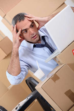 department head: Man surrounded by boxes