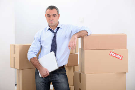 distributor: Man stood by stacked boxes
