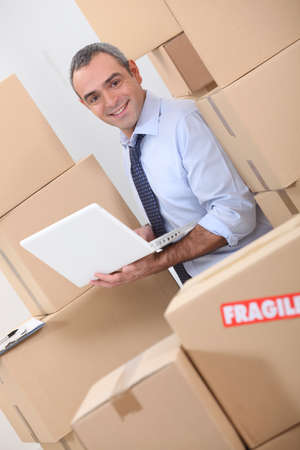 Warehouse manager with boxes photo