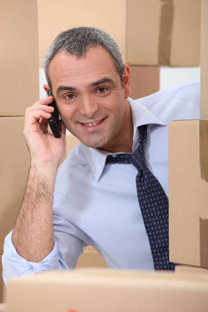 transfer pricing: Horizontal image of a man surrounded by cardboard