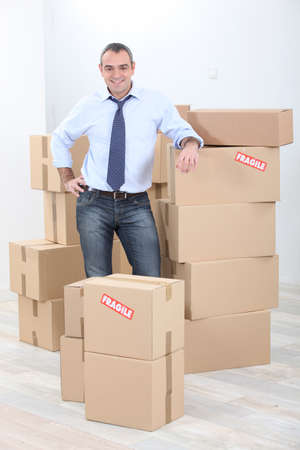 Horizontal image of a man surrounded by cardboard Stock Photo - 13867479