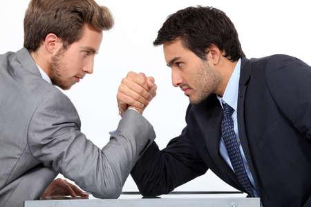 Men arm wrestling photo