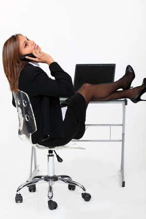 Secretary with feet on the table photo