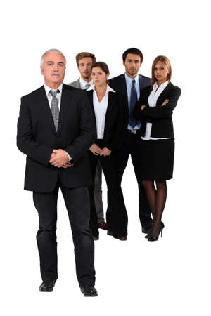 superiority: Studio shot of businessman and his team Stock Photo