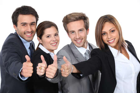 job interview: Four young professionals giving the thumbs up