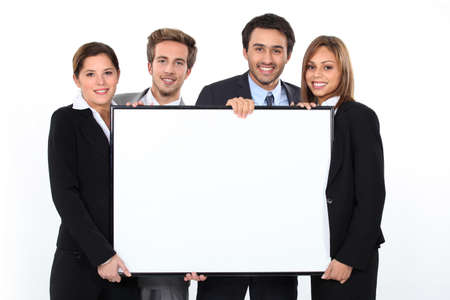 young executives: Business team holding blank poster